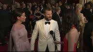 Exterior interview with actor Jamie Dornan accompanied by his wife Amelia Warner speaking about the atmosphere of the Oscars the likelihood that La...
