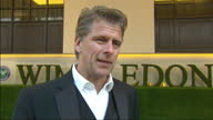 Exterior interview with former tennis player and now TV presenter Andrew Castle on the red carpet at the Wimbledon Championships Winners Ball 2013...