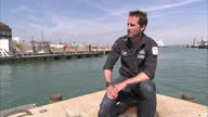 Exterior interview with Sir Ben Ainslie Olympic gold medallist in sailing speaking about Giles Scott winning the gold medal at Rio and the America's...