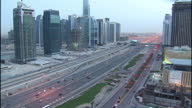 Exterior locked off shot of highway and buildings Sky Scrapers in Dubai at sunset dusk Locked off Dubai buildings and highway on November 30 2009 in...