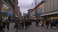 Exterior locked off shots pedestrians shoppers crowd walking in Manchester City Centre Center center on February 25 2015 in Manchester England