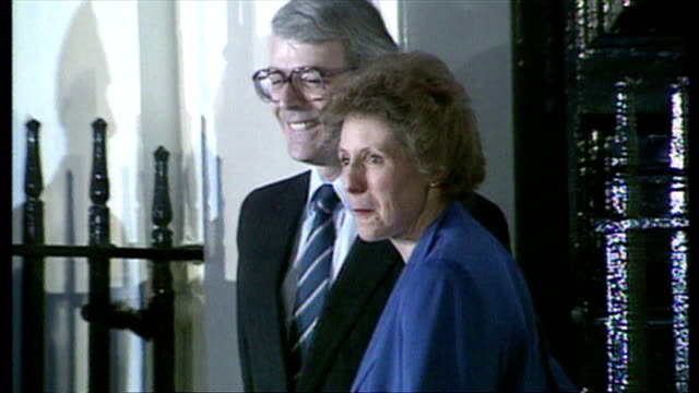 Exterior night shot John Major walks out of number 11 Downing Street with wife Norma Major and waves to the press after winning the Conservative...