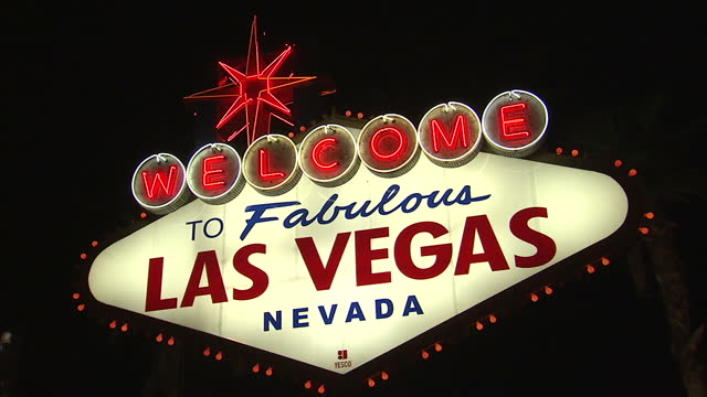Exterior night shot of 'Welcome To Las Vegas' sign illuminated against the night sky on 19th November 2012 in Las Vegas Nevada United States