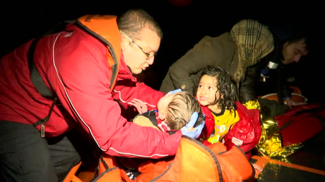 Exterior night shots aboard a rescue boat in the Aegean Sea as rescuers mount a mission to rescue stricken migrants including children whose boat has...