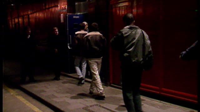 Exterior night shots bouncers standing on the door of Raquels nightclub and let clubbers into the club on November 17 1995 in London England