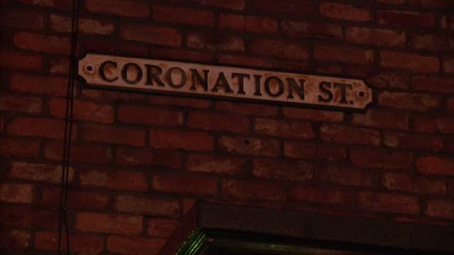 Exterior night shots Coronation Street set showing the Rovers Return pub semidetached houses Coronation Street sign Coronation Street Set Exteriors...