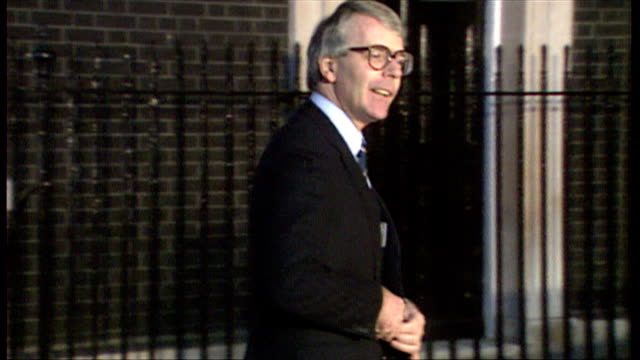 Exterior night shots John Major arriving outside Number 11 Downing Street after winning leadership race to become the new Prime Minister waving to...