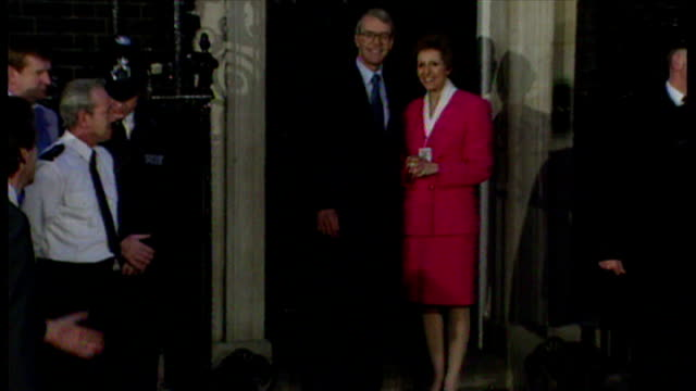 Exterior night shots John Major Prime Minister posing for the press on the doorstep of Number 10 Downing Street with his wife Norma Major after...