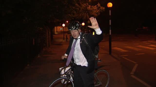 exterior night shots Mayor of London Boris Johnson returns home on bike says hello to press and goes inside Boris Johnson Returns Home on Bicycle on...