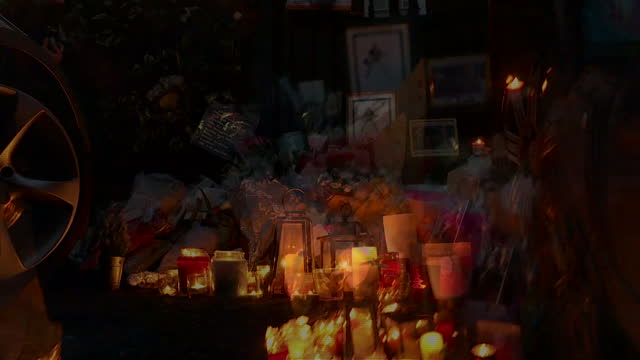 Exterior night shots of floral tributes and candles lit outside of George Michael's house on December 26 2016 in London England Tributes have poured...