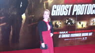 Exterior night shots of Gillian Anderson arriving at Mission Impossible 4 Ghost Protocol film premiere and posing for cameras on red carpet includes...