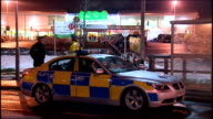 Exterior night shots of police activity in ASDA car park in Robroyston after Kevin Carroll was shot dead there Police gathered at entrance to car...