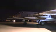 Exterior night shots of Russian Air Force Sukhoi Su 25 Frogfoot Close Air Support jets taking off from Latakia airbase en route to bombing opposition...