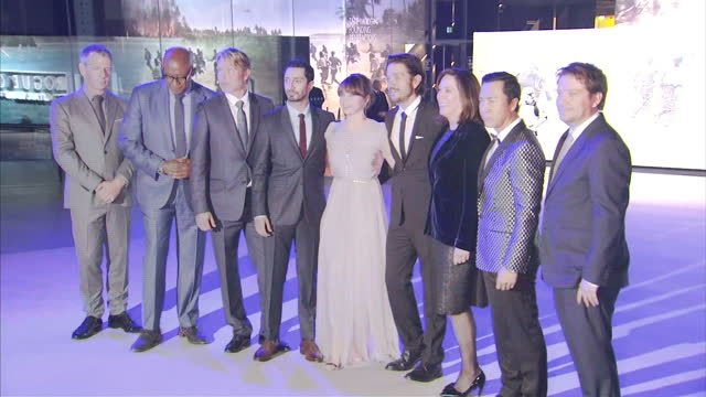 exterior night shots of the cast of Rogue One A Star Wars Story posing on the red carpet including Ben Mendelsohn Forest Whitaker Mads Mikkelsen Riz...