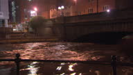Exterior night shots of the swollen River Aire running through central Leeds>> on December 26 2015 in Leeds United Kingdom