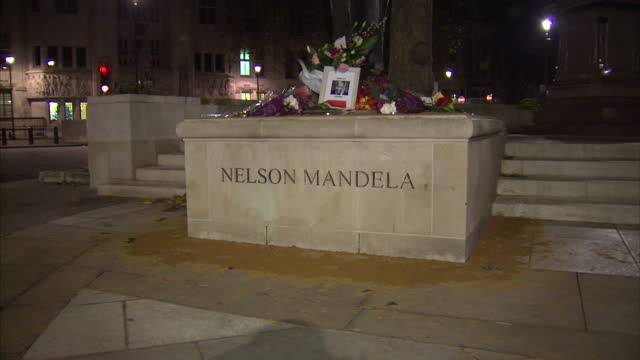 Exterior night shots of tributes left by members of the public at the foot of the statue of Nelson Mandela in Parliament Square The British public...