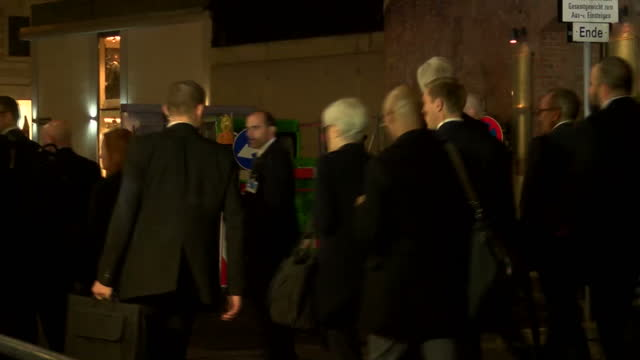 Exterior night shots of US Secretary of State John Kerry departing the Palais Coburg hotel after talks concerning Iran's nuclear programme and...