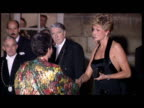 Exterior night shots Princess Diana arrives at Versailles Palace in glamourous black evening gown shakes hands w/ Madame AnneAnemone Giscard...