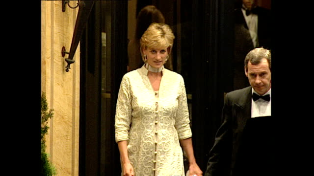 Exterior night shots Princess Diana departs Dorchester Hotel in long Indian design brocade coat over silk tunic trousers get into waiting car