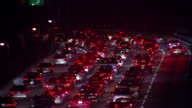 Exterior night time shots of busy traffic on a Los Angeles interstate with brake lights pulling in and out of focus on January 28 2015 in Los Angeles...