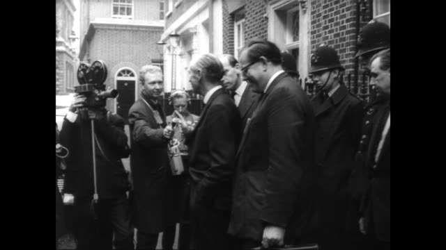 Exterior of 10 Downing Street / crowd lines the footpath leading up to the front door / Lord Halisham comes out of Number 10 to talk with press /...