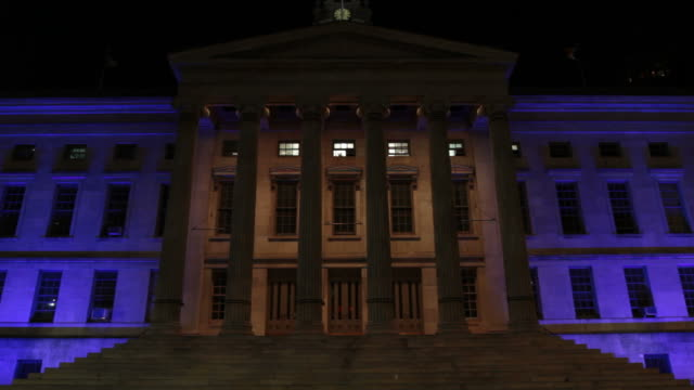 Exterior of a city courthouse at night.