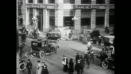 Exterior of Bank of Italy / traffic sped up / pedestrians cross streets