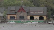 WS Exterior of College Boat Club located in Boathouse Row, with small boats passing by / Philadelphia, Pennsylvania, United States