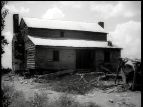 1944 MONTAGE Exterior of deserted farmhouse / United States
