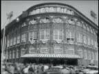 exterior of Ebbets Field with crowd arriving for the game / fans in the bleachers