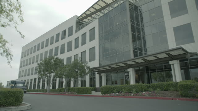 WS Exterior of large office building during the day