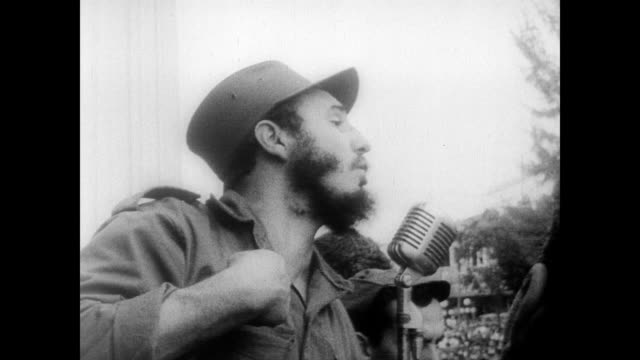 / exterior of presidential palace in Cuba / massive crowd surrounds the front of the building / aerial of the crowd / Castro gives speech from the...