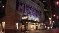 WS Exterior of Shubert Theatre with 'Memphis' musical ad illuminated at night, Broadway / New York City, New York, USA