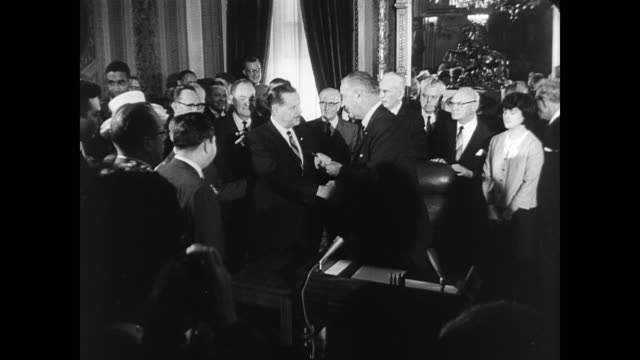 Exterior of White House in Washington DC / President Lyndon Johnson signs the 1965 Voting Rights Bill into law / Vice President Hubert Humphrey...