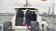 PORTSMOUTH Exterior point of view from boat Duke and Duchess of Cambridge sat on bow of Land Rover watching America's Cup