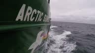 Exterior point of view shots from the deck of the ship Greenpeace Arctic Sunrise as she navigates the waters of the Barents Sea on July 12 2016 in...