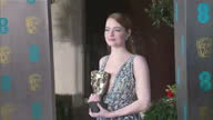 Exterior red carpet shots of Emma Stone Best Actress in a Leading Role holding award at the BAFTA Awards at the Royal Albert Hall on February 12th...