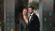 Exterior red carpet shots of Sam TaylorWood Director of 50 Shades of Grey with husband Aaron TaylorJohnson actor at the BAFTA Awards at the Royal...