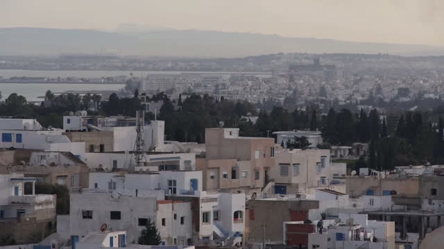 Exterior scenic shots of the Tunis city skyline including the AlZaytuna Mosque complex and traffic driving through the city>> on March 06 2015 in...