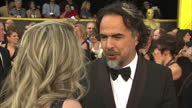 Exterior shot Alejandro Gonzalez Inarritu Director on Academy Awards red carpet talking about being nominated for Best Director for second year in a...