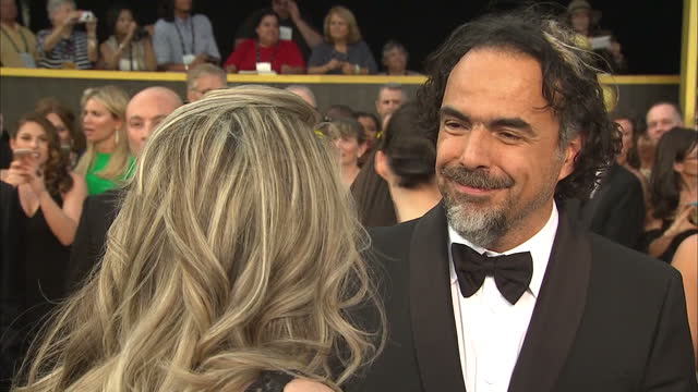 Exterior shot Alejandro Gonzalez Inarritu Director on Academy Awards red carpet talking about working with Leonardo DiCaprio on the film 'The...