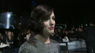 exterior shot Anne Hathaway red carpet interview speaking on film