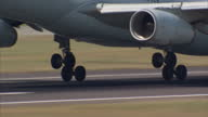 Exterior shot closeup of plane wheels landing on runway as Air Canada plane lands at Heathrow airport on July 01 2015 in London England