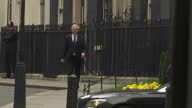 Exterior shot David Davis MP Brexit Secretary walks into 10 Downing Street in London England on Tuesday 14th March 2017