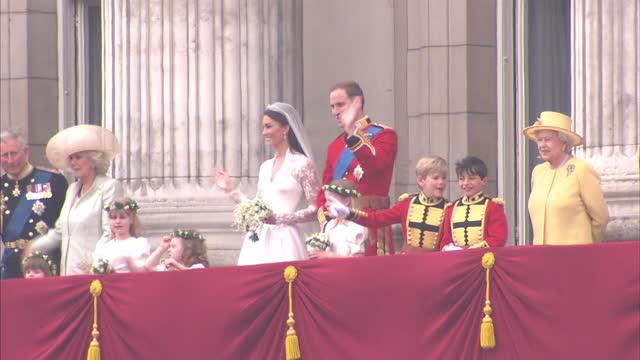 Exterior shot from ground level of William Catherine on Buckingham Palace Balcony Long shot of William Catherine on Balcony with Queen Shots include...