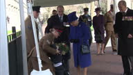 Exterior shot Her Majesty The Queen and Prince Phillip Duke of Edinburgh meet and greet couple with young child Funnies moment where the toddler...