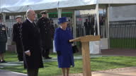 Exterior shot Her Majesty The Queen and Prince Phillip Duke of Edinburgh unveil war memorial sculpture releasing the robe covering the piece Zoom in...
