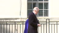 Exterior shot Her Majesty The Queen walks up to new memorial piece wearing a blue coat and hat at war memorial service The memorial honoured the...