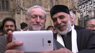 Exterior shot Jeremy Corbyn MP Labour Leader taking a selfie with unknown man on October 12 2015 in London England