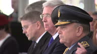 Exterior shot Michael Fallon UK Secretary of State for Defence sat down at a war memorial service which honoured the service and duty of both the UK...